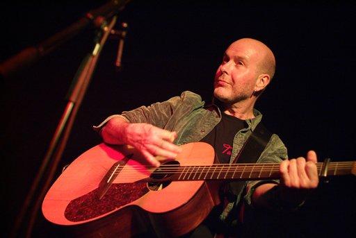 Photo of Keiran Halpin with guitar